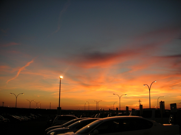 sunset_over_the_car_rental_by_dream_this_life_away